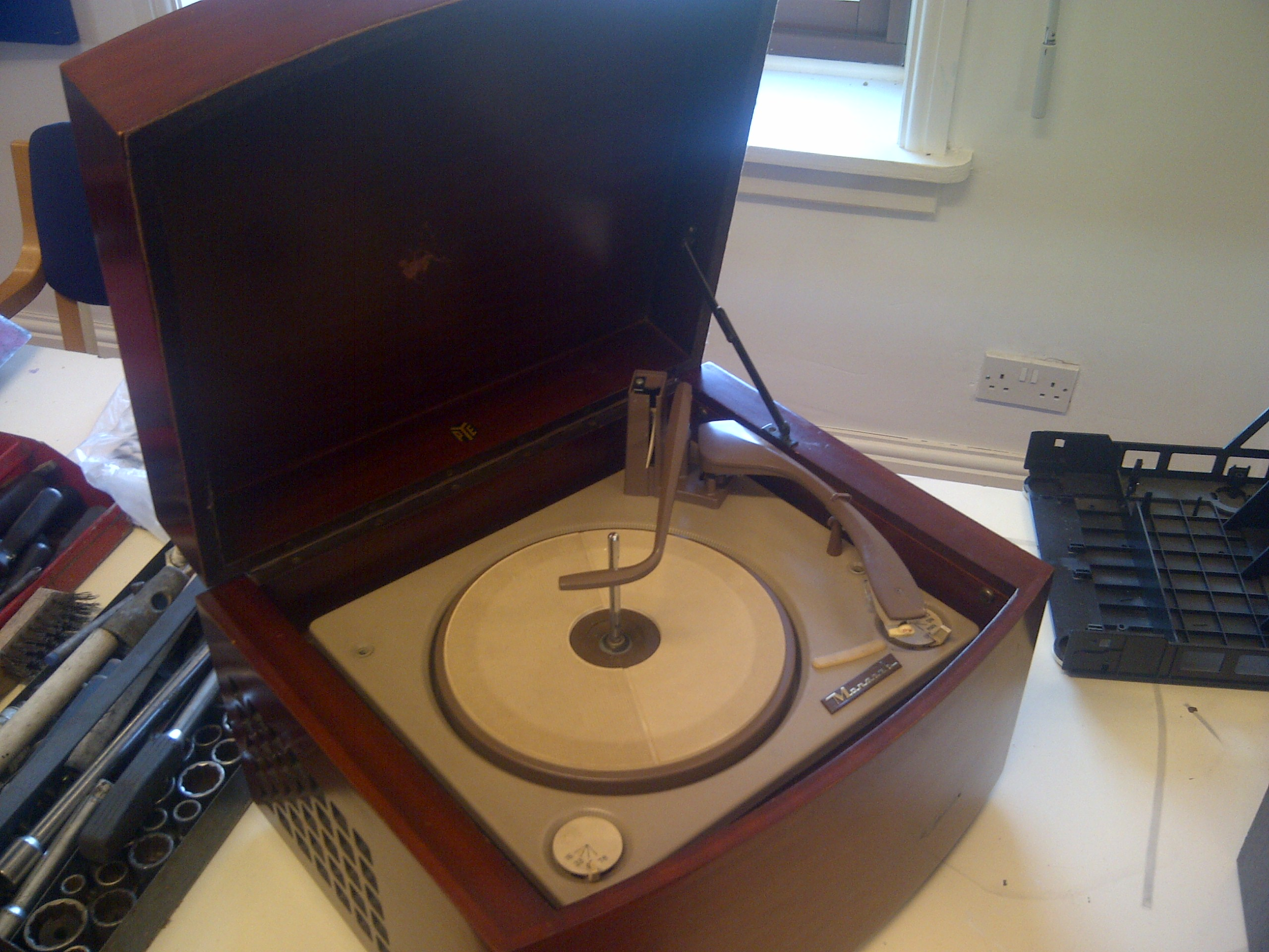 This record player had been rescued from a tip by a relative of the guy who brought it in.