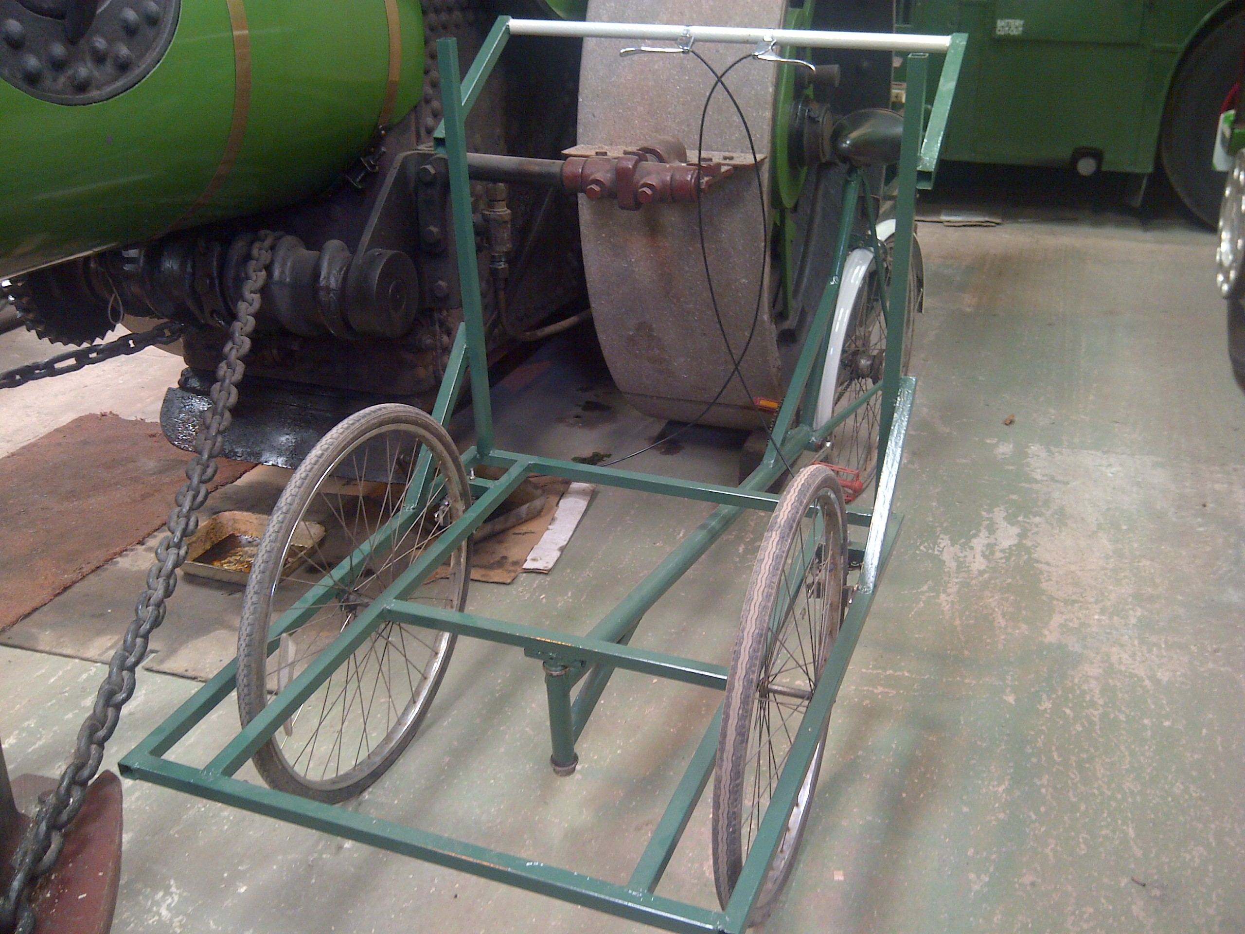 With all the required modifications carried out, the tricycle frame was painted, first with red oxide primer, then with a dark green colour, which was from an old tin of paint obtained for free!